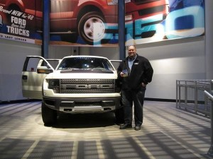 Craig beside the 2013 Ford Raptor SVT at the Ford Rouge Factory in Dearborn, Michigan